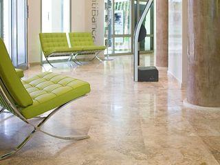 Pavimenti per banche Pietre di Rapolano Spazi commerciali moderni Pietra Beige