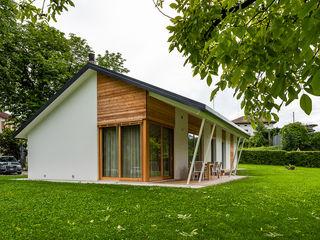 Woodbau Srl Chalets & maisons en bois Bois Effet bois