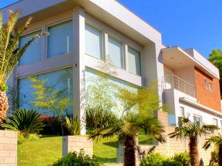 ANDRÉ PACHECO ARQUITETURA Rumah tinggal Batu Bata Grey