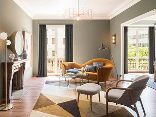 The Room Studio Soggiorno eclettico