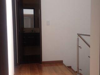 Erick Becerra Arquitecto Classic corridor, hallway & stairs Wood-Plastic Composite Wood effect