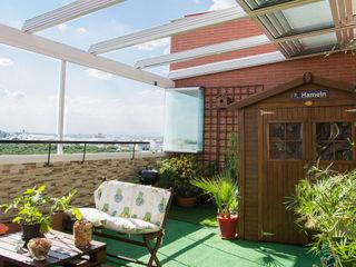 Cerramiento de techo móvil cortina de cristal Fraimar Aluminios S.L. Balcones y terrazas de estilo moderno Aluminio/Cinc Blanco