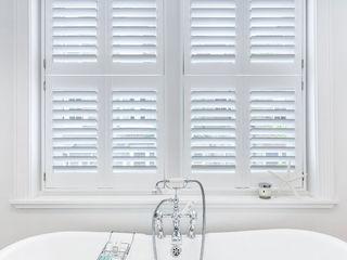 A Wonderfully Pristine Home in Battersea Plantation Shutters Ltd Phòng tắm phong cách hiện đại Gỗ White