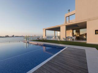 Vivienda unifamiliar Cerámica Saloni Casas de estilo minimalista Cerámico