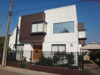 Vivienda García por ARKITEKTURA ARKITEKTURA Casas unifamiliares Ladrillos Blanco
