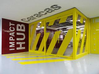 Oficinas Impact Hub Caracas RRA Arquitectura Oficinas de estilo industrial Vidrio Amarillo
