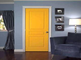 كاسل للإستشارات الهندسية وأعمال الديكور والتشطيبات العامة Wooden doors Chipboard Yellow