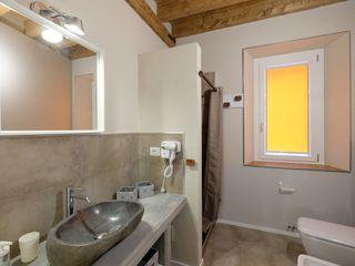 architetto Davide Fornero Salle de bain moderne Béton Beige