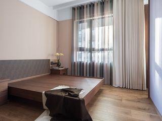 次臥二則採用大地色系 宸域空間設計有限公司 小臥室 Brown
