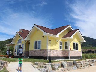 나무집협동조합 Casas de estilo rústico