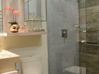 Graça Brenner Arquitetura e Interiores Casas de banho modernas Betão Cinzento