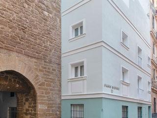 REHABILITACIÓN DE EDIFICIO PARA DOS VIVIENDAS pxq arquitectos Casas multifamiliares Verde