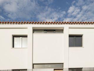 Boost Studio Modern houses Concrete White