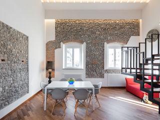 La cascina in città B+P architetti Sala da pranzo moderna