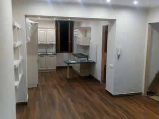 Progettazione di un open space con cucina a vista Omnia Multiservizi - Roma Invest Soggiorno in stile coloniale
