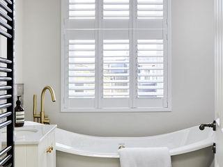 A Stunning Scandi Style Home in Fulham Plantation Shutters Ltd Phòng tắm phong cách Bắc Âu MDF White