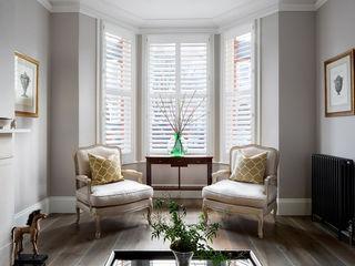 A Classic Contemporary Home in Clapham South Plantation Shutters Ltd Phòng khách Than củi White