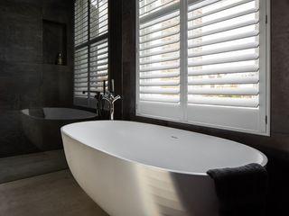 A Classic Contemporary Home in Clapham South Plantation Shutters Ltd Phòng tắm phong cách hiện đại Gỗ White