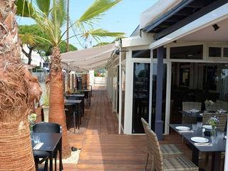 Decoración Restaurante Un Lugar Palets de Lujo Paredes y suelosColores y acabados Madera maciza Acabado en madera