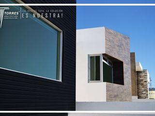 Conjunto Casas LV Torres Arquitectos Proyecto y Construcción Paredes y pisos de estilo rústico Concreto Gris