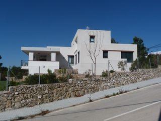 Estudio1403, COOP.V. Arquitectos en Valencia Casas unifamiliares Blanco