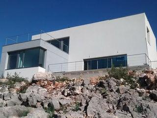 Estudio1403, COOP.V. Arquitectos en Valencia Casas unifamiliares