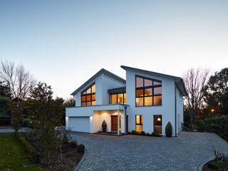 Modern Three Storey Townhouse Bennett Baufritz (UK) Ltd. Casas unifamiliares Madera Blanco