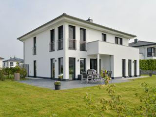 Stadtvilla aus Massivholz Herrmann Massivholzhaus GmbH Holzhaus Massivholz Weiß