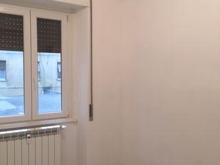 Ristrutturazione rapida - Via Collalto Sabino Finchamp Costruzioni S.r.l. Camera da letto moderna