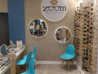 Interiores de ótica em shopping Izabella Biancardine Interiores Lojas & Imóveis comerciais modernos Turquesa