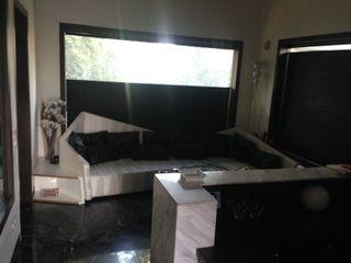 7WD Design Studio Salas de estar modernas Madeira Preto