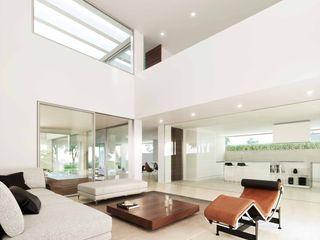 Casa unifamiliar de obra nueva Otto Medem Arquitecto vanguardista en Madrid Salones de estilo moderno