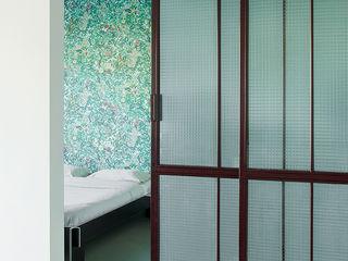 Loft PR Manuela Tognoli Architettura Camera da letto in stile industriale