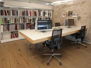 viemme61 Oficinas y comercios de estilo industrial