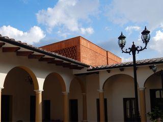 AGE/Alejandro Gaona Estudio Casas de estilo rústico Ladrillos Rojo