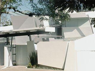 AGE/Alejandro Gaona Estudio Casas unifamilares Hormigón Blanco