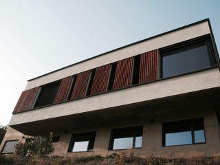 Maison d'Architecte IND Architecture Volets Bois massif Effet bois