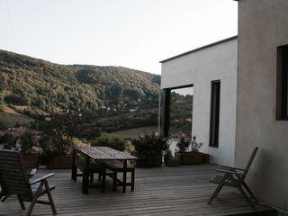 Maison d'Architecte IND Architecture JardinAbris de jardin & serres Bois massif Marron