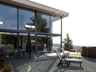 Construcción de Casa Moderna en L'Ametlla del Vallès Esteve Arquitectes Casas ecológicas Aluminio/Cinc Negro