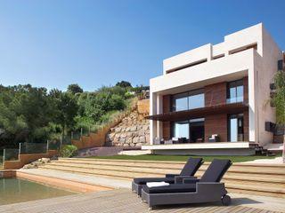 Casa ecológica moderna en Llavaneres Esteve Arquitectes Casas unifamilares Piedra Blanco
