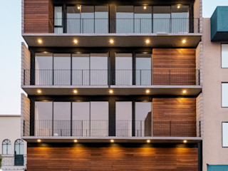 Miguel de la Torre Arquitectos Casas multifamiliares Hormigón Acabado en madera