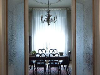 Appartamento Liberty in centro storico Studio di Architettura IATTONI Sala da pranzoAccessori & Decorazioni