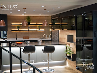 Beautifully lit Intuo glass kitchen Intuo Modern style kitchen