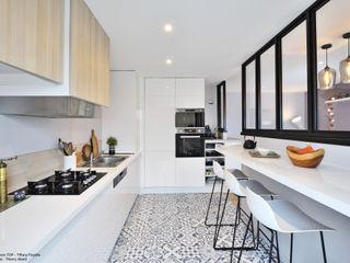 Rénovation complète avec ouverture de cuisine à Lyon Tiffany FAYOLLE Cuisine intégrée