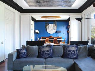 Vivienda de estilo neoyorquino en Avenida Diagonal MANUEL TORRES DESIGN SalonesSofás y sillones Azul