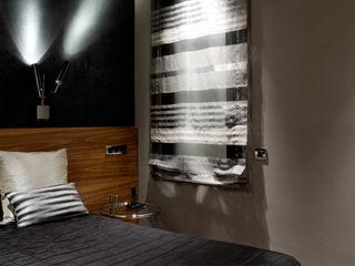 PROYECTO DE INTERIORISMO VIVIENDA EIXAMPLE BARCELONES MANUEL TORRES DESIGN Dormitorios pequeños Acabado en madera