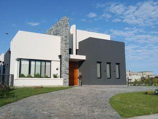 MONARQ ESTUDIO Single family home Stone