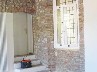studiolineacurvarchitetti Living room Stone Beige