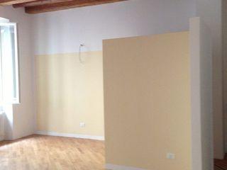 studiolineacurvarchitetti Living room Wood Amber/Gold