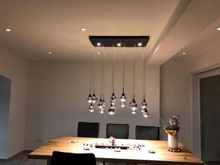 DSHP Gebäudeautomation und Energie GmbH Modern dining room